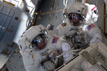 Astronauts Andrew Feustel (right) and Michael Fincke, outside the ISS during the STS-134 mission's third spacewalk.