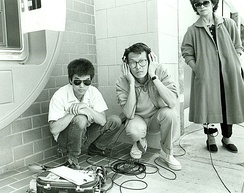Sound recordist Curtis Choy (left) on location for Dim Sum: a Little Bit of Heart, an indie film by director Wayne Wang (center) on Clement Street in the Richmond District of San Francisco, California 1983
