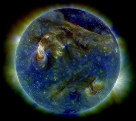 On August 1, 2010, the Sun shows a C3-class solar flare (white area on upper left), a solar tsunami (wave-like structure, upper right) and multiple filaments of magnetism lifting off the stellar surface.[9]