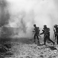 Men of the 7th Battalion, Green Howards, stage a re-enactment of the storming of Point 85 during the Gabes Gap battles, 11 April 1943.