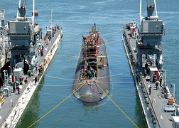 Arco (ARDM-5), an ARDM-5-class floating dry dock, servicing a Los Angeles-class submarine