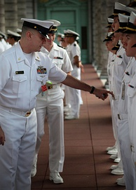 U.S. Naval Academy Midshipman being inspected wearing Summer Whites