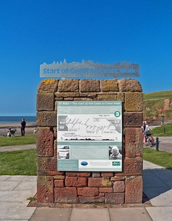 The start of the Wainwright Coast to Coast Walk at St Bees Seacote beach. Sign refurbished 2013 and stainless steel start banner added; a joint project between Wainwright Society and St Bees Parish Council.