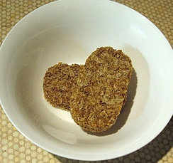 Two dry Weetabix in a bowl