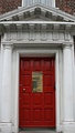 Door with a pediment, a Doric frieze and two Doric columns, in Dublin (Ireland)