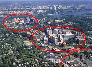 Aerial view of Rosslyn-Ballston corridor in Arlington, Virginia. High density, mixed use development is concentrated within ¼–½ mile from the Rosslyn, Court House and Clarendon Washington Metro stations (shown in red), with limited density outside that area.  This photograph is taken from the United States Environmental Protection Agency [18] website describing Arlington's award for overall excellence in smart growth in 2002 — the first ever granted by the agency.