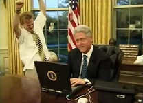 President Bill Clinton (right) with television actor Mike Maronna (left) celebrating a successful online purchase in a comedic short film recorded for the 2000 Dinner.