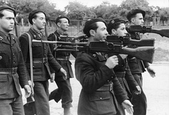 Military parade of the French Milice armed with machineguns in 1944.