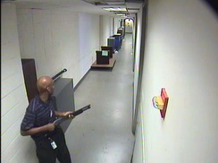 Aaron Alexis holding a shotgun during his rampage.