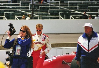 Davey Hamilton (left) and car owner A. J. Foyt (right) walk through the pit area on Tuesday after the race.