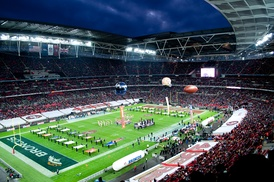 Photograph of London's Wembley Stadium during the opening ceremony of the 2010 NFL International series showing the field and the stands filled with fans