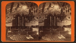 The interior of the Salt Lake Tabernacle as decorated for the Deseret Sunday School Union's July 1875 Pioneer Day celebration.