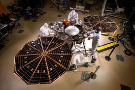 The InSight lander with solar panels deployed in a cleanroom