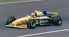 Roberto Moreno driving the FG01 at the 1995 British Grand Prix. He retired on lap 48 when the car's hydraulic pressure dropped.