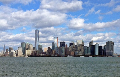 The Financial District of Lower Manhattan viewed from New York Harbor, near the Statue of Liberty, October 2013