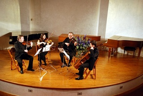 A string quartet in performance. From left to right – violin 1, violin 2, viola, cello
