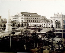 The first theatre (left), in front of Plaza de Mayo in 1881, photo by Alexander Witcomb.