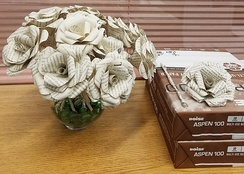 Roses made from upcycled library books.