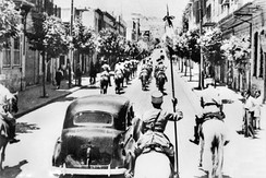 The fall of Damascus to the Allies, late June 1941. A car carrying Free French commanders General Georges Catroux and General Paul Louis Le Gentilhomme enters the city, escorted by French Circassian cavalry (Gardes Tcherkess).