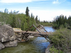 Replica log bridge at Aishihik River crossing