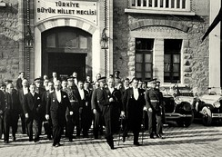 President Mustafa Kemal Atatürk (center) and Prime Minister İsmet İnönü (left) leaving the Grand National Assembly of Turkey during the 7th anniversary celebrations of the Turkish Republic in 1930.