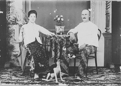 Dutch colonial couple in early 20th century wore native batik and kebaya fashion.