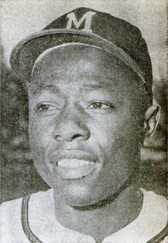 A black-and-white photo of Hank Aaron