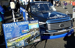 Moffitt's championship winning truck with sponsor Aisin on display in Japan.