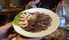 A platter of horse meat served traditionally as an appetizer.