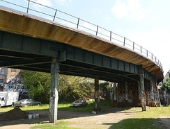 The Myrtle Avenue–Chambers Street Line (later the 10, then the M train) used the Myrtle Viaduct (pictured) along its route between Manhattan and Middle Village
