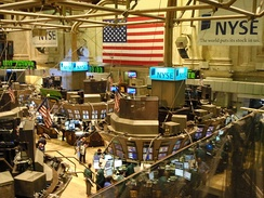 The New York Stock Exchange trading floor (economic power such as a large nominal GDP and a world reserve currency are important factors in projection of hard power)
