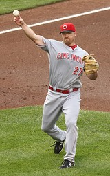 Scott Rolen wearing the current Reds away uniform, featuring classic lettering.