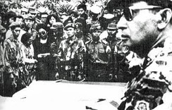 As Major General, Suharto (at right, foreground) attends the funeral of assassinated generals 5 October 1965. (Photo by the Department of Information, Indonesia)