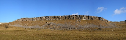 Cliffs of Carboniferous Limestone are a common geological feature in the Yorkshire Dales; this panoramic image shows the western face of Thwaites Scars taken from Long Lane.