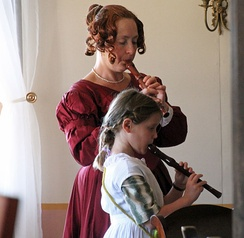 A woman and girl playing recorders at Fort Ross State Historic Park in 2015
