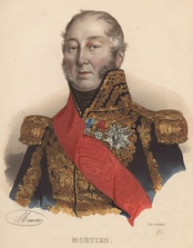 Colored print shows a hatless, balding man with long sideburns. He wears an elaborate dark blue military coat with gold epaulettes and a red sash across his right shoulder. The coat front and the collar are completely covered in gold lace.