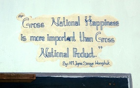Slogan in Bhutan about gross national happiness in Thimphu's School of Traditional Arts.