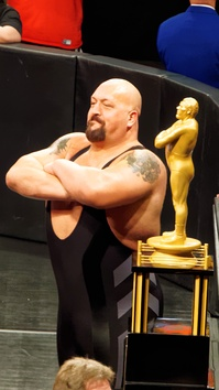 Big Show – a wrestler often compared with Roussimoff due to his size – was the winner of the 2015 André the Giant Memorial Battle Royal at WrestleMania 31, and is posing alongside the André the Giant Memorial Trophy, which goes to the winner of the annual match.