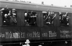 German soldiers in a railway car on the way to the front in August 1914. The message on the car reads Von München über Metz nach Paris. (From Munich via Metz to Paris).