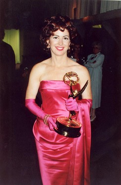 Actress Dana Delany holding a Primetime Emmy Award in 1992