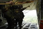 Airmen of the 710th Special Operations Wing prepare to jump from a KC-130 during Parachute Operations training.