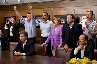 Cameron, Barack Obama, Angela Merkel, François Hollande, and others watch the penalty shootout of the 2012 UEFA Champions League Final. Cameron is celebrating Chelsea's victory.