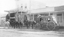 A Kinnear Express stagecoach operating from Tombstone to Bisbee in the 1880s. This thorough-brace stagecoach used thick leather straps to support the body of the carriage and serve as shock-absorbing springs.