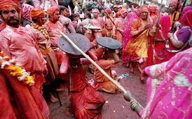 In the Braj region of North India, women have the option to playfully hit men who save themselves with shields; for the day, men are culturally expected to accept whatever women dish out to them. This ritual is called Lath Mar Holi.[79]