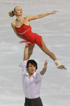 A one arm overhead lift in pair skating