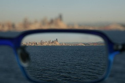 Seattle skyline as seen through a corrective lens, showing the effect of refraction