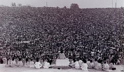 Swami Satchidananda giving the opening talk at the Woodstock Festival of 1969