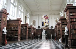 Wren Library interior, showing the limewood carvings by Grinling Gibbons