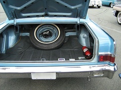 A trunk in the rear will often contain a spare tire