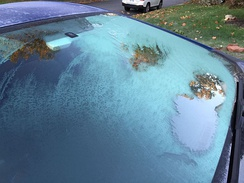 Ice formation on exterior of vehicle windshield